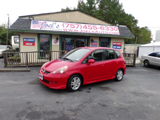 2007 Red Honda Fit Sport 5-Speed MT (JHMGD37647S) with an 1.5L L4 SOHC 16V engine, 5-Speed Manual Overdrive transmission, located at 5700 Curlew Drive, Norfolk, VA, 23502, (757) 455-6330, 36.841885, -76.209412 - Photo #0