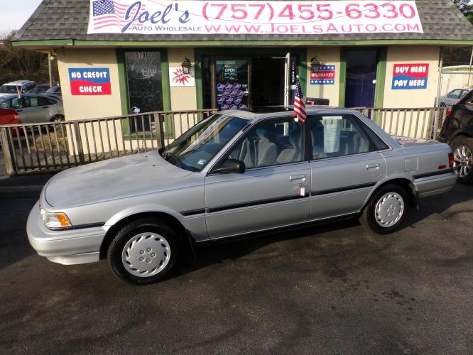 1991 Silver Toyota Camry DLX (4T1SV21E5MU) with an 2.0L L4 SOHC 8V engine, located at 5700 Curlew Drive, Norfolk, VA, 23502, (757) 455-6330, 36.841885, -76.209412 - Photo #0