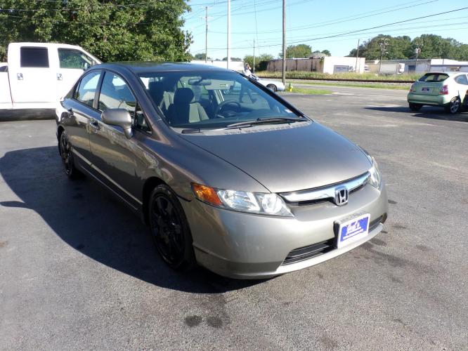 2007 Gray Honda Civic LX Sedan (1HGFA155X7L) with an 1.8L L4 SOHC 16V engine, 5-Speed Manual Overdrive transmission, located at 5700 Curlew Drive, Norfolk, VA, 23502, (757) 455-6330, 36.841885, -76.209412 - Photo #2