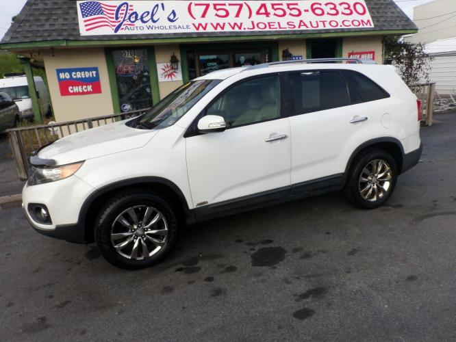 2011 WHITE Kia Sorento EX 4WD (5XYKUDA19BG) with an 2.4L L4 DOHC 16V engine, 6-Speed Automatic transmission, located at 5700 Curlew Drive, Norfolk, VA, 23502, (757) 455-6330, 36.841885, -76.209412 - Photo #0
